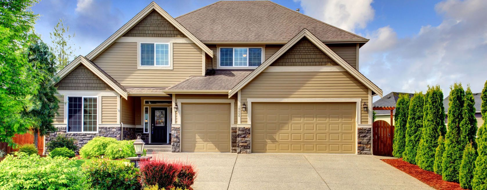 27139616 - beige luxury house tih stone trim base  view of porch, garage and driveway