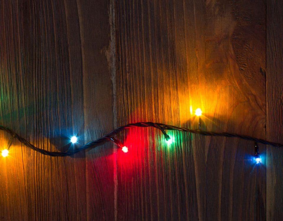 Holiday lights on wood planks