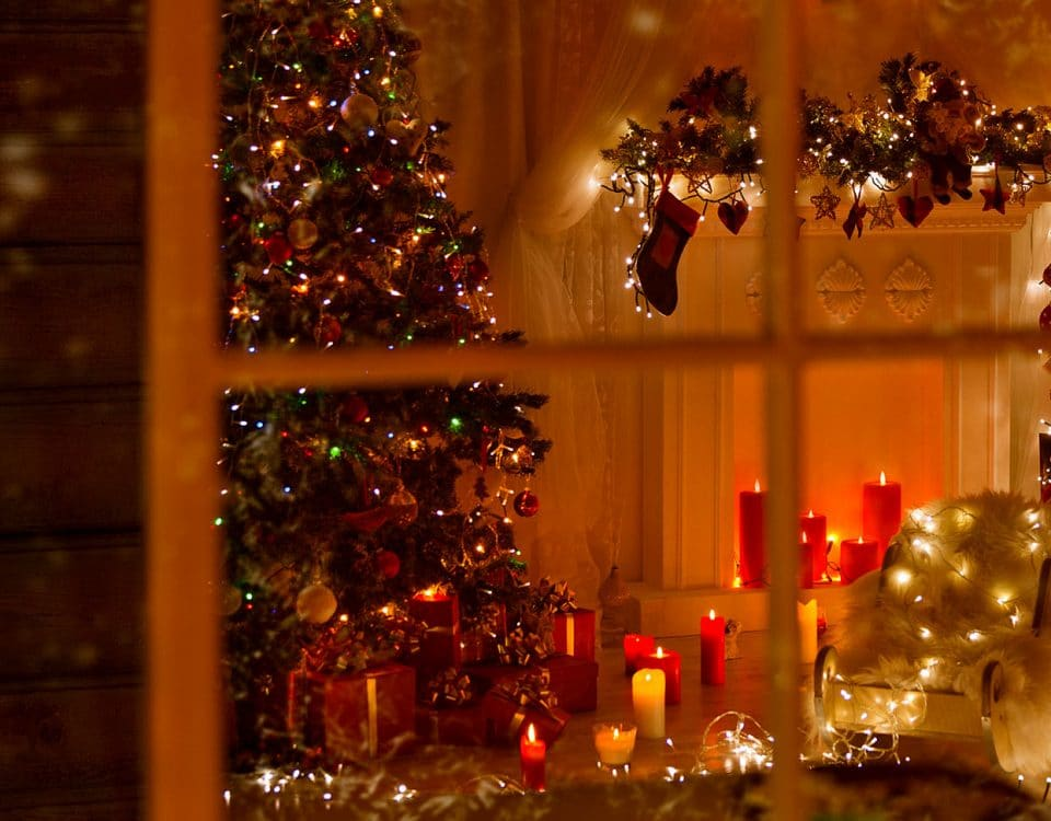 View into home with christmas tree candles and lights