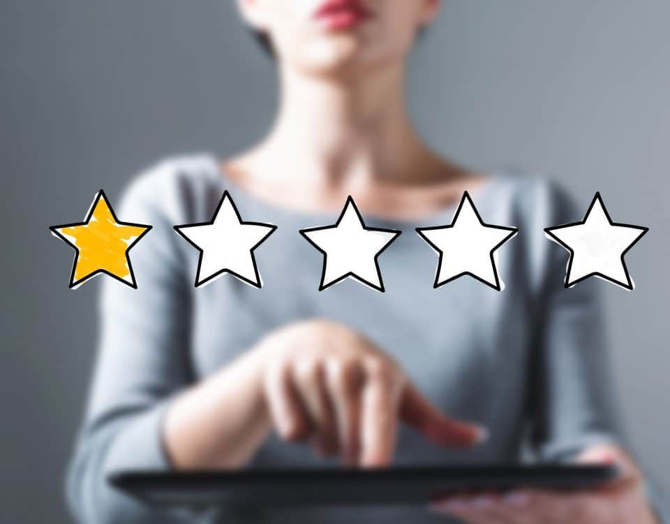 One star rating with business woman using a tablet computer